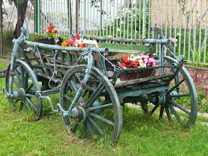 Photo: Old wheels in Velence, Hungary, Many flowers in this village.