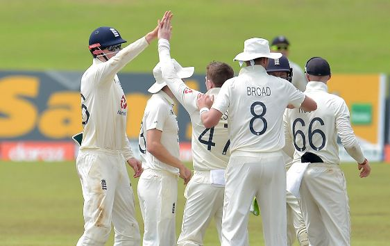 England players celebrate after taking a wicket.
