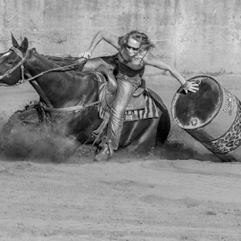 Trying to hold it up by Joe Saladino - Black & White Sports ( horse, barrel race, monochrome, rider, sport )