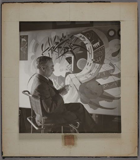 "Wassily Kandinsky in his studio in Neuilly-sur-Seine in front of ""Dominant Curve"""
