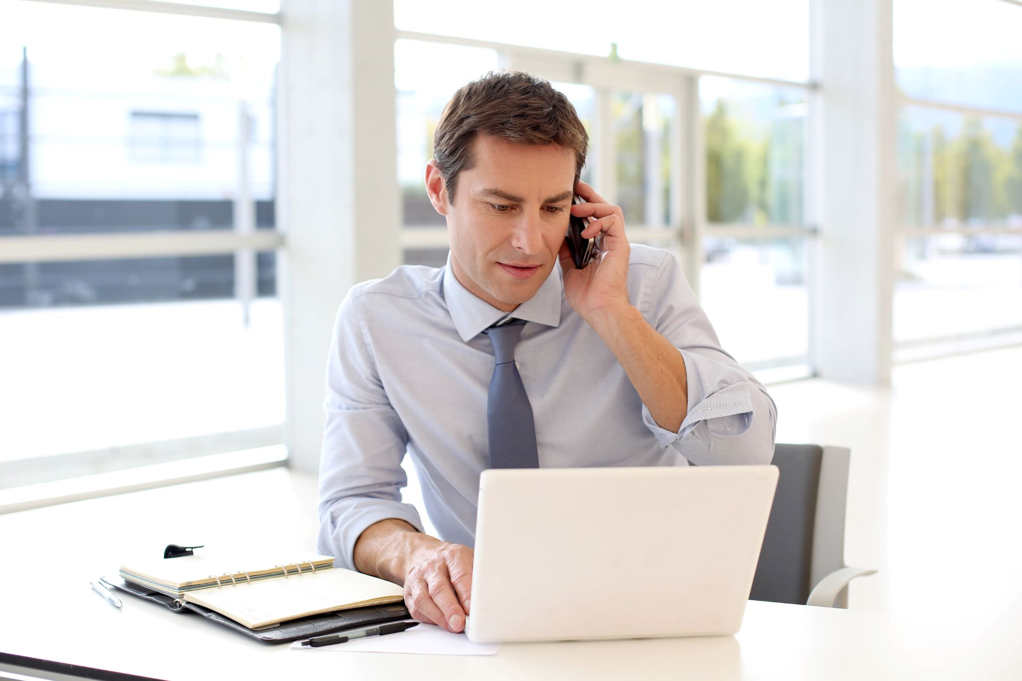 A business owner calling his insurance provider to update his policy