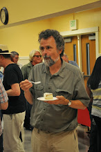 Photo: Dennis Caswell checks out the cake.