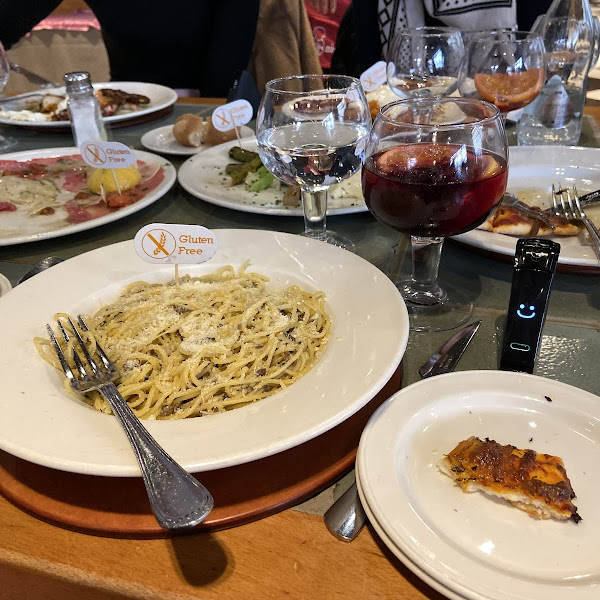 Very very happy with this meal !! They have separate kitchens for GF meals vs non-GF meals. The pasta was delicious - spaghetti with mushrooms and truffle oil. The pizza was less good, but tasty!