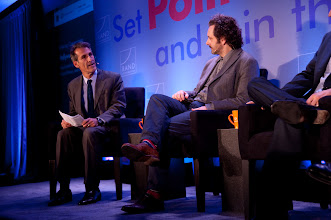 """Photo: Moderator Michael Lynton asks Michael Sheen a question during the """"Hollywood and Policy"""" panel discussion Friday, Nov. 16 at the RAND Politics Aside event in Santa Monica."""