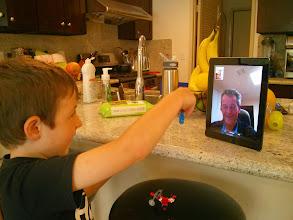 Photo: Showing Grandpa Legos via Face Time