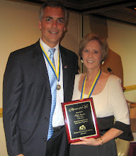 "Photo: Ruth Swanto receiving the ""Rotarian of the Year"" Award from President Joe Johnson for her tireless work in providing a Guest Speaker for every club meeting throughout the year!"