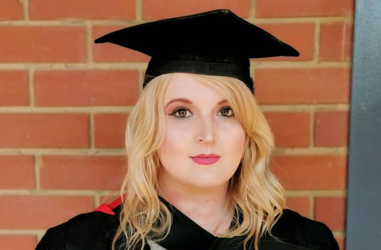 Student makes history at NWU with doctorate at 25, fighting financial hardship and anxiety disorder