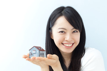 women happy that her house is structurally sound