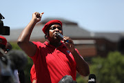 EFF deputy president Floyd Shivambu addresses party members outside the Tiso Blackstar offices in Parktown, Johannesburg where public enterprises minister Pravin Gordhan appeared before the state capture inquiry on Monday, November 19 2018.