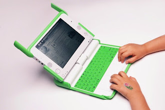 Photo: OLPC XO as the laptop is called, showing the keyboard adapted to kids hands - there's a slightly larger one for youth, and surfing the wikipedia - another open source project as OLPC XO-XServer is one too.