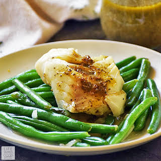Poached Cod with Pesto Wine Sauce.