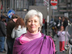 Photo: Pat in a borrowed scarf. We arrived a day later than planned, and our luggage was two days late.
