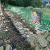 Foundations being laced in dry stone wall repair