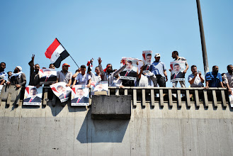 Photo: Supporters of Egypt's ousted president Mohamed Morsi stage a mass march to demand his return to power. Morsi was overthrown by the military in the face of popular pressure on July 3rd. EGYPT - 26/7/2013. Credit: Ali Mustafa/SIPA Press