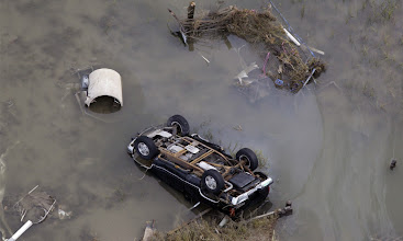 Photo: An overturned car sits in floodwaters from Hurricane Ike September 14, 2008 in Gilchrist, Texas. Floodwaters from Hurricane Ike are reportedly as high as eight feet in some areas causing widespread damage across the coast of Texas.   AFP PHOTO/POOL/David J. Phillip (Photo credit should read DAVID J. PHILLIP/AFP/Getty Images)