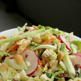 Brussels Sprout, Cabbage & Tofu Slaw with Coconut-Peanut Dressing