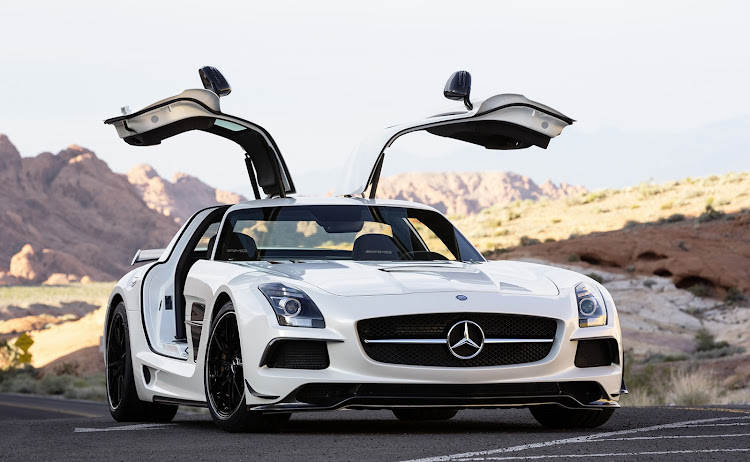 The SLS was the first car developed from the ground up by Mercedes-AMG, and its gullwing doors hide a secret trick.