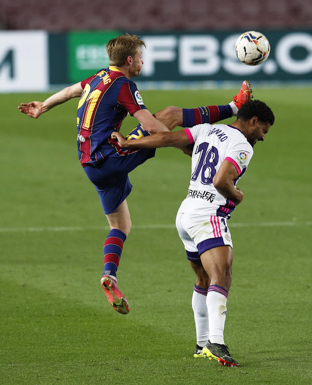 Barcelona's Frenkie de Jong in action with Real Valladolid's Saidy Janko