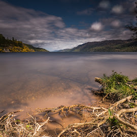 Loch Ness by Haim Rosenfeld - Landscapes Waterscapes ( exposure, scotland, old, mountain, europe, colorful, land, stone, rock, yellow, travel, north, landscape, adventure, sky, tree, kingdom, shadow, dreamlike, nikon, light, lonely, foreground, clouds, orange, united, uk, celtic, texture, roots, colors, green, ness, scottish, horizon, image, brawn, lake, scenic, loch, highlands, photo, blue, outdoor, brown, scenery, stunning, britain )