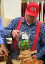Photo: Bob Grudberg shows his working M&M dispenser.   He had trouble finding a glass jar to use for it. ...