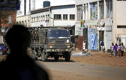 Members of the military patrol the streets of Harare, Zimbabwe. Picture: REUTERS /SIPHIWE SIBEKO