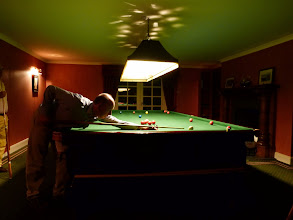 Photo: Adrian lining up a red after dinner (Game abandoned due to lack of potting!)