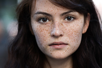"""Photo: She was walking with her boyfriend. When I approached them, they seemed startled, but as I explained what I was trying to do, they said 'yes'. But I could still feel them being unsure about the whole thing. Looking at this portrait, I'm reminded of the quote: """"A girl without freckles is like a night without stars."""""""