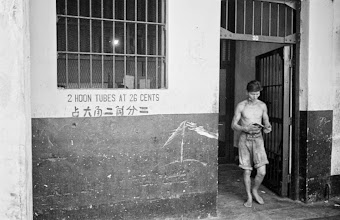 Photo: Photographer: Harrison Forman Singapore, man walking out of building of opium seller, 1941 Hoon refers to a unit of weight used to measure opium in British-controlled China.