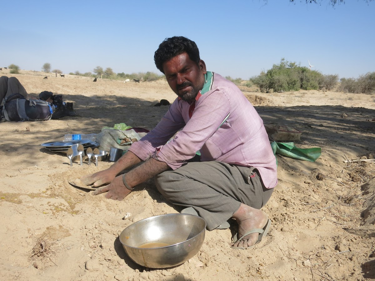 India. Rajasthan Thar Desert Camel Trek. Kitchen cleanup - desert style: with the sand!