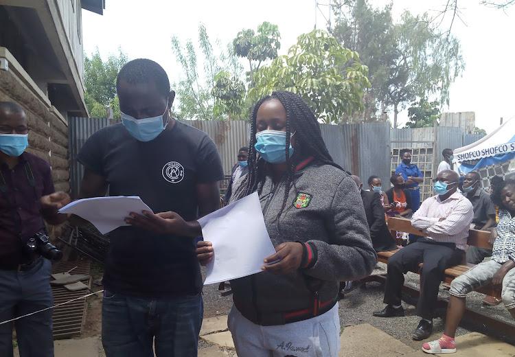 Gideon Mbusu and Mary Mukii Kioko in the open Kibera law court.