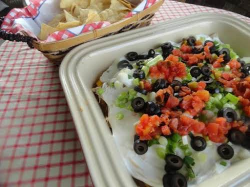 """Layered Chicken Nacho Dip """"This dip is going to be a HUGE..."""