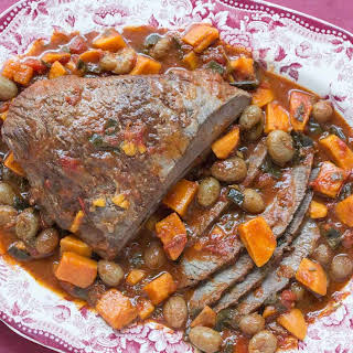 Sweet & Sour Brisket with Red Wine, Grapes and Sweet Potatoes.