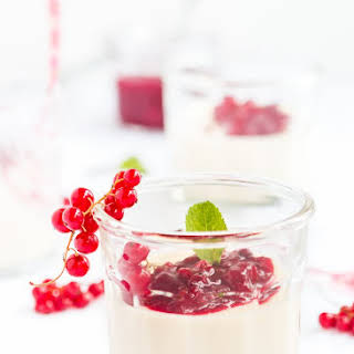 White Chocolate Panna Cotta with Red Currant Sauce.