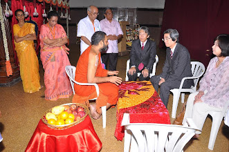 """Photo: Mr.Masanori Nakano, the Consul General of Japan Embassy accompanied by his wife, and Mr.Tsuyoshi Yamane, visited HH Swamiji and paid their respects. They expressed their gratitude to HH for the help done by Swamiji's organization when they were in trouble during tsunami. They said, """"We are deeply touched by the concern and help you have extended. Our people are deeply touched with the help""""."""