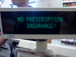 Photo: The prescription savings club is even promoted on the register screen. It took me 5 tries to get this photo!