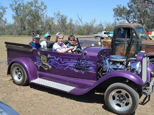 George, Edward and Alex Bennett and Jacob Cohen  were impressed with the hot rod.