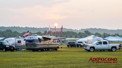 Photo: The sun rises over a classic Airstream aluminum skinned Motor home.  These they don't make anymore.