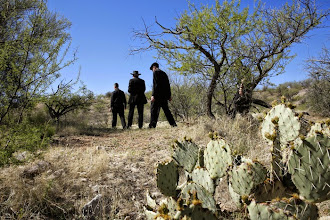 Photo: A group of U.S. bishops hikes through the Arizona desert about 30 miles north of Nogales March 31. They were exploring an area where many migrants make their way after illegally crossing into the U.S. from Mexico. The hike was part of two-day tour focused on border issues in Nogales. The tour included an April Mass celebrated in memory of those who have died while crossing the desert. (CNS photo/Nancy Wiechec) (April 1, 2014)