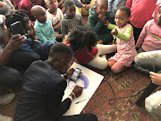 Sinazo Peters and her friends meet with groups of children at schools and orphanages through the Mkhulise Foundation to give motivational talks.