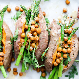 Stuffed Sweet Potatoes with Chickpeas, Asparagus and Arugula.