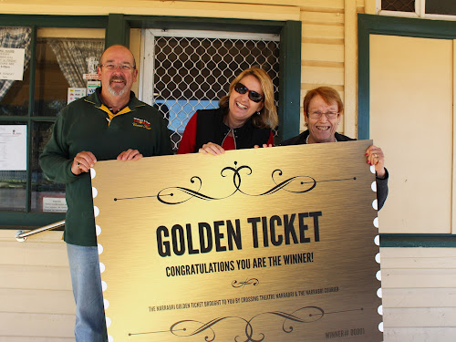 Kathy Bailey holding the ticket with Thomas' corner store owners Graeme and Sue Thomas.