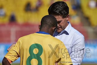 Photo: Coach McKinstry speaks to Captain Haruna Niyonzima (8) befor eextra time. [Rwanda vs Sudan, CECAFA 2015, Semi final, 3 Dec 2015 in Addis Ababa, Ethiopia.  Photo © Darren McKinstry 2015, www.XtraTimeSports.net]