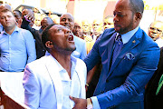 Alleluia International Ministries pastor Alph Lukau 'resurrects' Brighton 'Elliot' Moyo, who was already in his coffin.