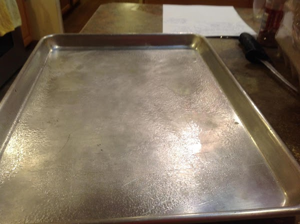 Spray a shallow jelly Roll type baking pan with non stick cooking spray.