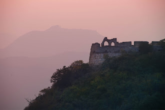 Photo: Ruins at the Great Wall after the sun sets  Yesterday, I kept hiking along the old wall as the sun set. I also had a zoom lens (28-300mm) with me, so I was able to get in tight on far away structures and shapes. Not too long after I took this shot, I walked along several lengths of the wall to get to these ruins. I stood there for a long time listening to music and taking photos.  The next photo I put here in Google+ will be of the wall in the morning -- what it looks like to be inside the fauna and vegetation that has taken over this remote part of the the original wall.  #greatwall #china #SICInDatabase