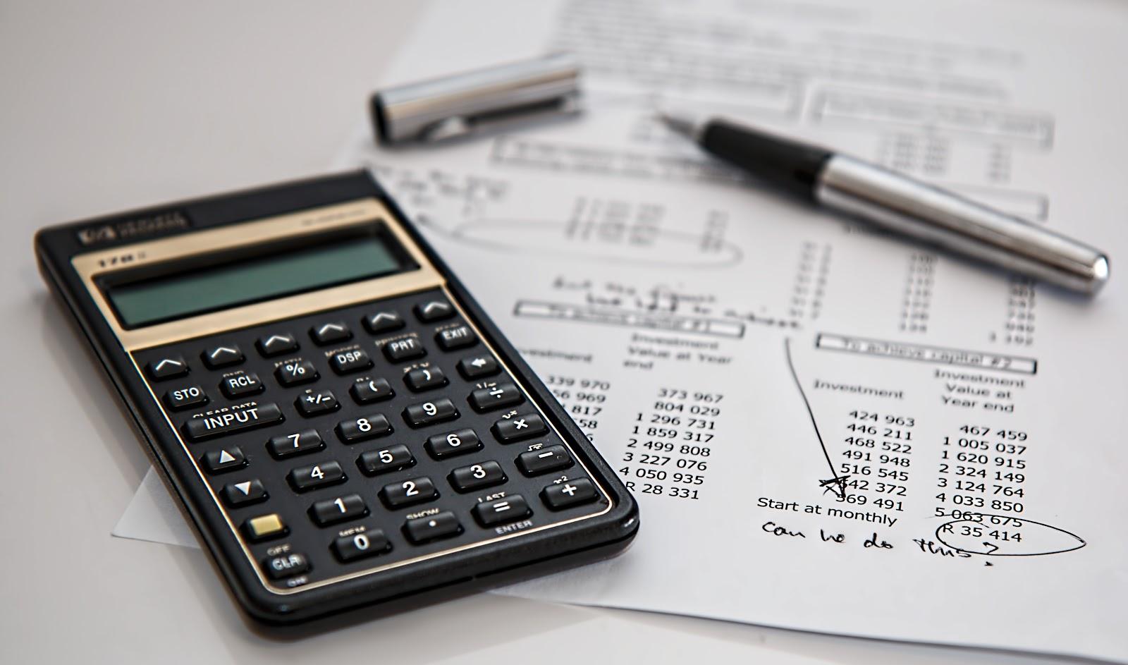 A calculator next to a balance sheet