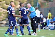 Gavin Hunt having a word with Thulani Hlatshwayo during the Absa Premiership match between Bidvest Wits and Maritzburg United at Bidvest Stadium on May 07, 2017 in Johannesburg, South Africa.