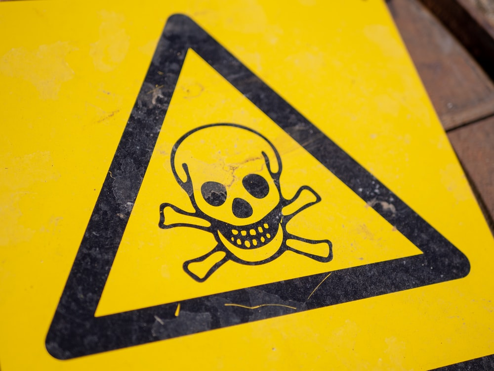 black and yellow poison sign