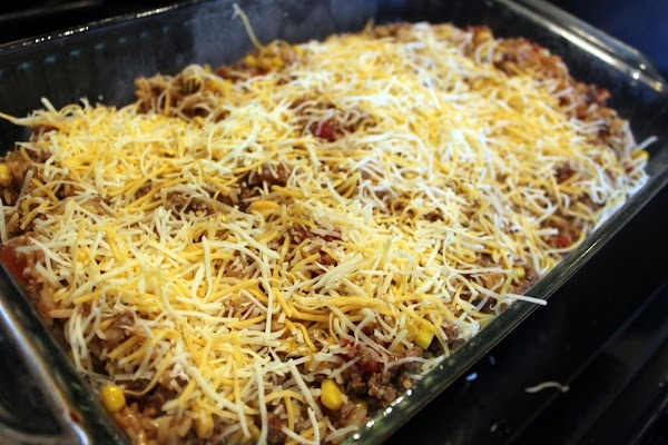 Cheese sprinkled over casserole.