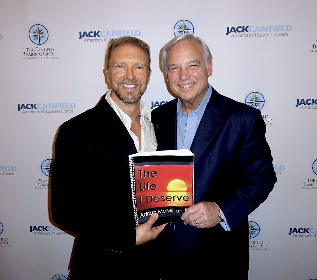 Adrian McMillian and Jack Canfield holding The Life I Deserve Book